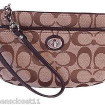 Coach Parker Signature Turnlock Medium Wristlet in Khaki Mahogany Photo