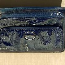 Coach Patent Leather Wristlet in Excellent Used Condition. Color Is Navy. Photo