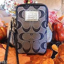 Coach Poppy Black & Gold Cell Phone Wristlet Photo