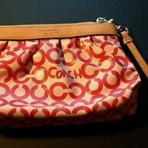 Coach Small Pink Wristlet With Credit Card Holders.  Photo