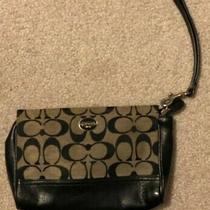 Coach Small Wristlet Canvas and Leather With Black Coach Patterns Photo