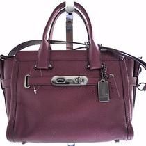 Coach Swagger 27 in Metallic Cherry Pebble Leather Purse 36497 Photo