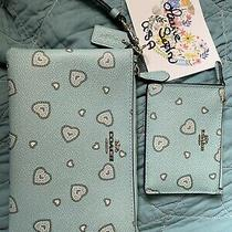 Coach Western Hearts Wristlet and Skinny Mini Gently Used Photo