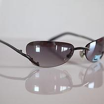 Dark Chrome Rimless Frame Gray Lenses by Level One Diva Photo