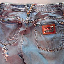 Dolce Gabbana  and Gucci. Two  Jeans 46 at a Low Price Photo