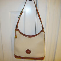 Dooney and Bourke Cream With Tan Trim Pebbled Leather Bag Great Condition.  Photo