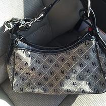 Dooney and Bourke Hobo With Signiture Khaki and Black Leather. Used Photo
