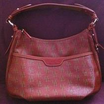 Dooney and Bourke Red Handbag With Db Decoration on Purse Photo