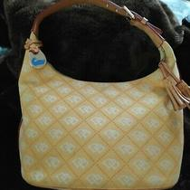 Dooney and Bourke Yellow Canvas Logo Signature Print Tassel Bucket Hobo Bag Photo