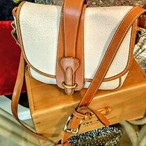 Dooney & Bourke All Weather Leather True White & Britishtan Crossbody Saddle Bag Photo