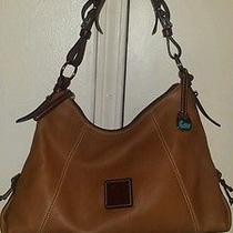 Dooney & Bourke Pebble Leather Brown Hobo Handbag.  Photo