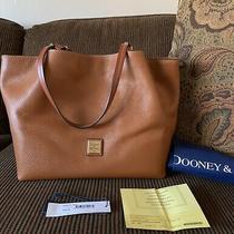 Dooney & Bourke Pebble Leather Flynn Shoulder Bag in Caramel. Photo