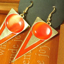E178 h&m Goldtone Triangle With Orange Glass Cat's Eye Earrings New on Card Photo