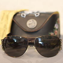 Ed Hardy Sunglasses     Warby Parker / Ray Ban / Swarovski / Oakley / Tom Ford Photo