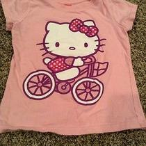 Euc Hello Kitty by Sanrio 6 Pink Shirt Riding a Bike Photo