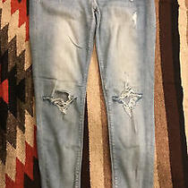Express Supersoft Cropped Mid Rise Jean Leggings Size 2 Light Blue Distressed Photo