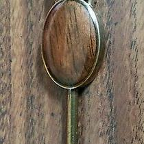 Fossil Hang Tag Emblem Wood Grain and Brass Finishes 2 1/2