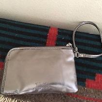 Fossil Women's Shiny Silver Metallic Zip Wristlet Pouch Wallet Photo