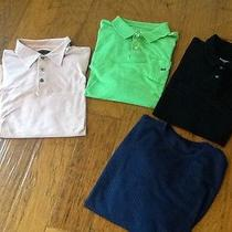 Four Men's Shirts X-Large and Large Photo