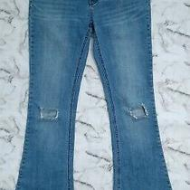 Free People Flare Leg Jeans Size 29 Distressed Busted Knee Hole Light Wash Blue Photo