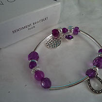 Girl's Stretch Bracelet With Silvertone & Purple Charms Photo