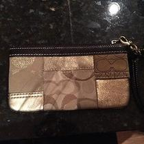 Gold and Brown Leather Coach Wristlet Photo
