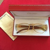 Gold Cartier Glasses With Wood Handles Photo