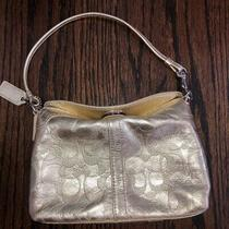 Gold Coach Turnlock Leather Wristlet Photo