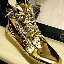 Gold Hightop Balmain Sneakers With Gold Chain. Photo