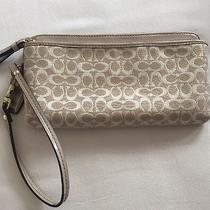 Gold/tan Coach Wristlet Photo