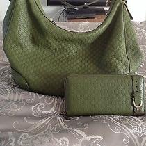 Green Leather Hobo Gucci Purse With Matching Leather Check Book Gucci Wallet. Photo