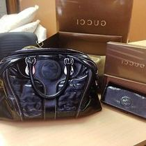 Gucci Black Handbag and Wallet Photo