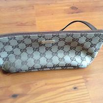 Gucci Brown and Tan Clutch Photo