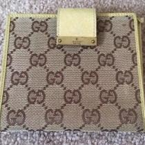 Gucci Gg Monigramed Bifold Wallet Photo