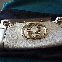 Gucci Gold Leather Clutch Photo