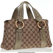 Gucci Gold Metallic Leather Classic Monogram Canvas Tote Bag With Gold Bamboo  Photo