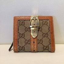Gucci Monogram Wallet With Gold Buckle Photo