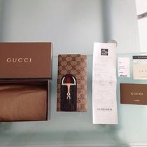 Gucci Monogrammed Wallet Photo