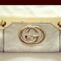 Gucci Starlight Clutch in Gold Photo