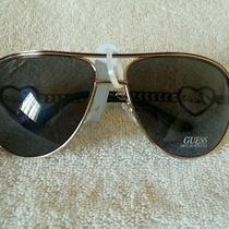 Guess Sunglasses Gu 7105 Shiny Gold 65mm Photo