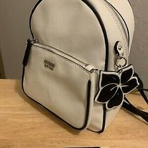 Guess Women's Backpack Purse White With Black Straps and Flower Charm Photo