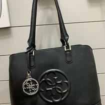 Guess Women's Black Large Tote Bag Handbag Purse Insignia Tag/ Imprint on Front Photo