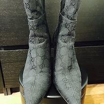 Guggi Boots Photo