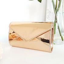Ikrush Women's Amel Metallic Envelope Clutch Bag  in Rose Gold Size 1size Photo