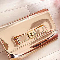 Ikrush Women's Nadia Metallic Bow Detail Clutch Bag  in Rose Gold Size 1size Photo