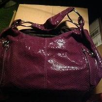 Jennifer Lopez Purple Hobo Photo