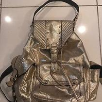 Juicy Couture Gold Backpack Purse Photo
