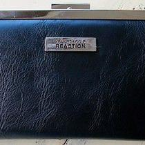 Kenneth Cole Woman's Black & Chrome Wallet Photo