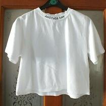 Ladies Short Round Neck White T-Shirt With Neck Writing by Urban Outfitters. Si Photo