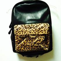 Leather and Leopard Print Bookbag Photo